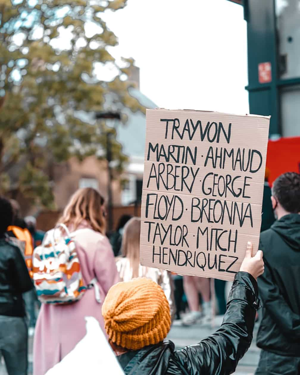 Anti-racism protester with sign